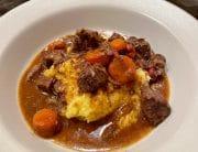 Cranberry Cider Braised Beef Stew on Polenta