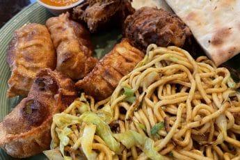 Center Himalayan Noodles, Clockwise: momos, pikora and Naan